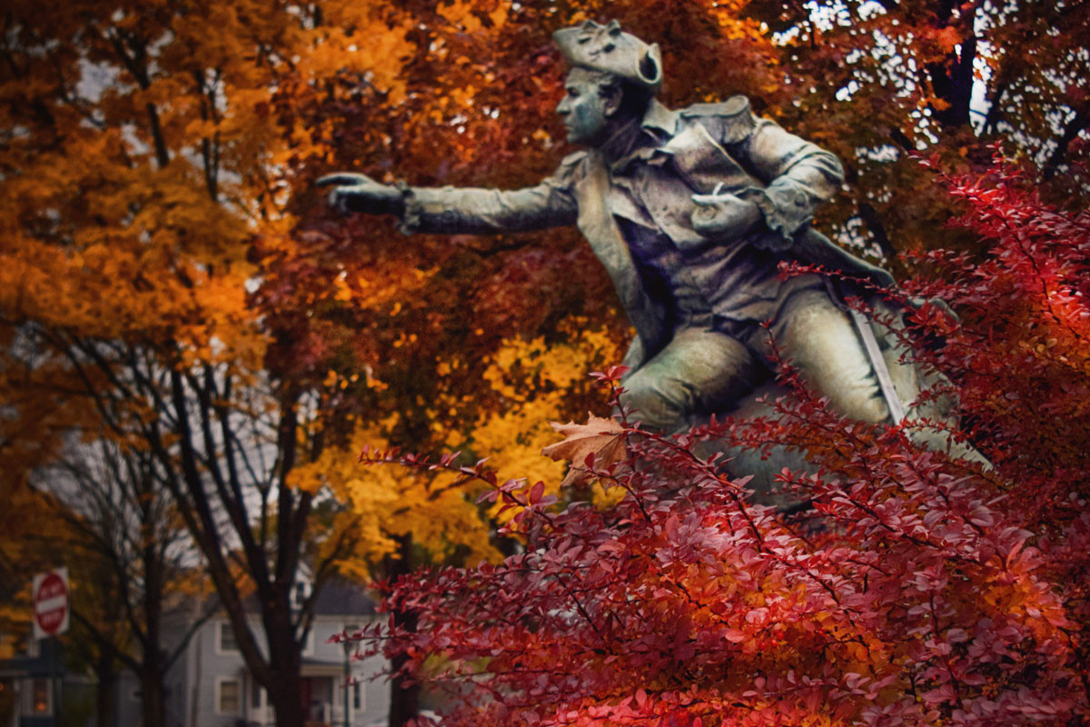 Statue in fall foilage.