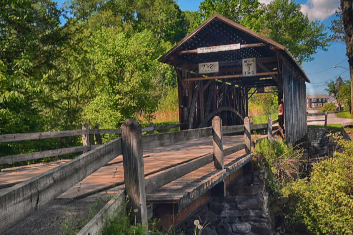 Photo of old wooden bridge in summer.